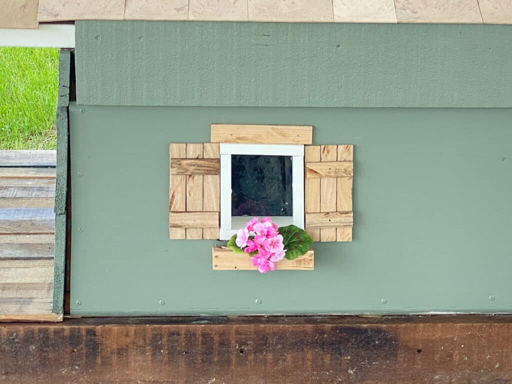 craftsman style wood shutters with oak window box with pink flowers built by fearless diy