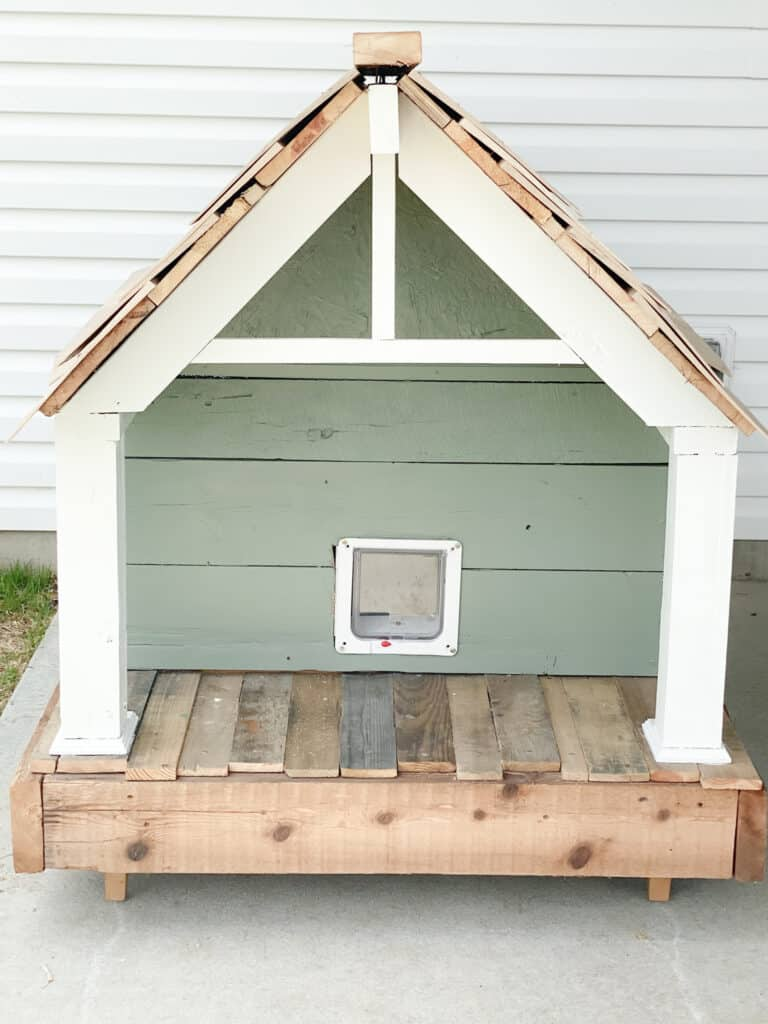 craftsman cat house with cedar shake roof, green pain and white columns and gable built by fearless diy