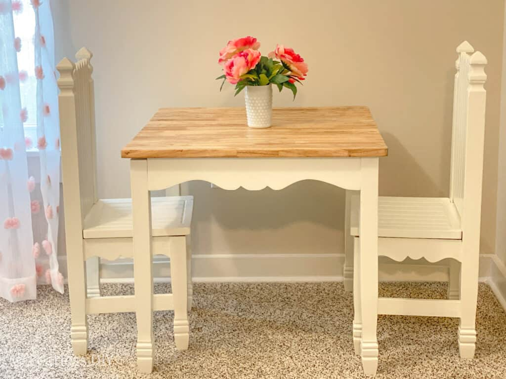 Childs table and chair set legs painted white, top natural finish with pink flowers on top refinished by fearlessdiy