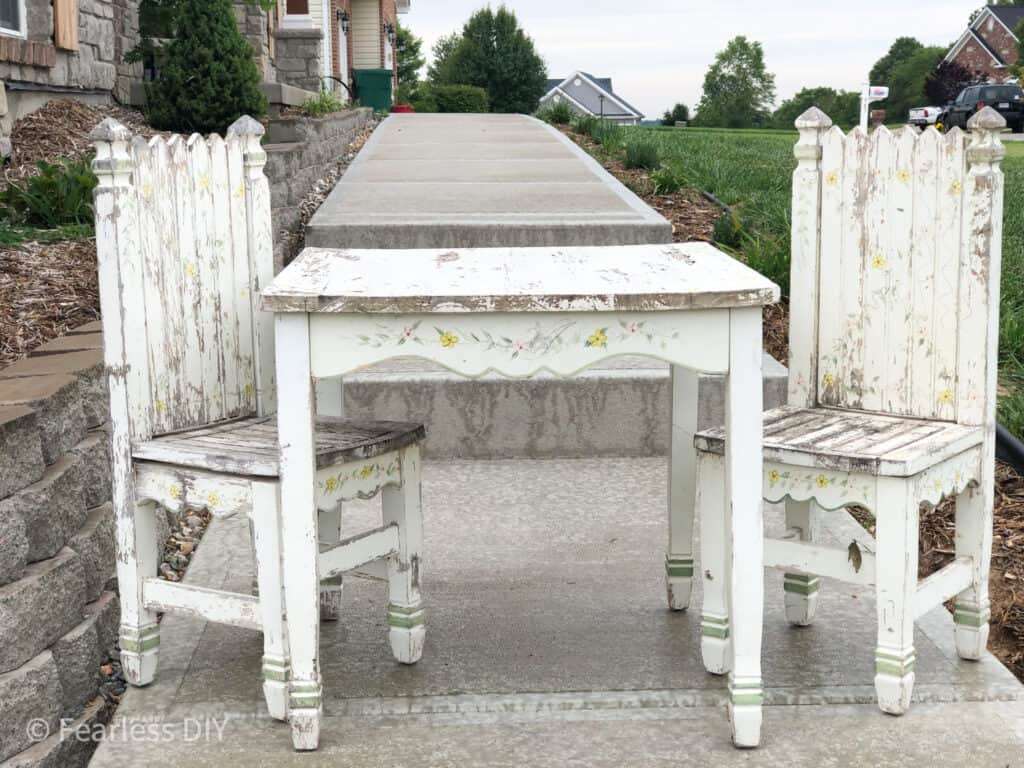 worn out childs table and chairs with chippy paint and rough edges