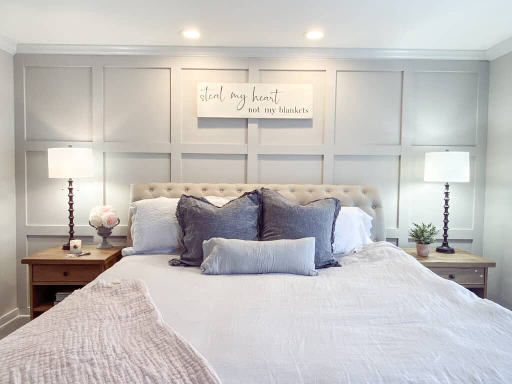 DIY board and batten wall in master bedroom with tufted headboard